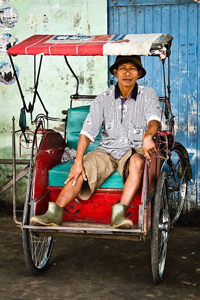 Bicycle taxi driver stock photo