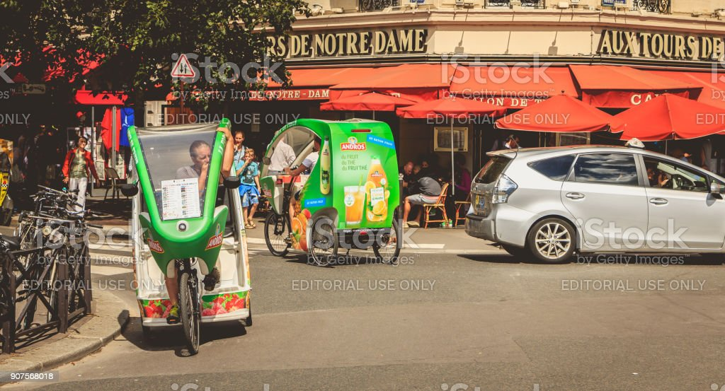 bicycle taxis drivers wait for customers in front of a terrace stock photo