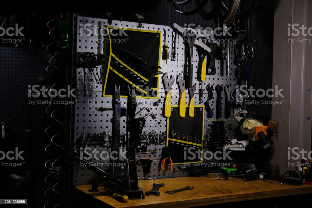 Bicycle tools on a wall. Bike mechanic garage with workshop tools...