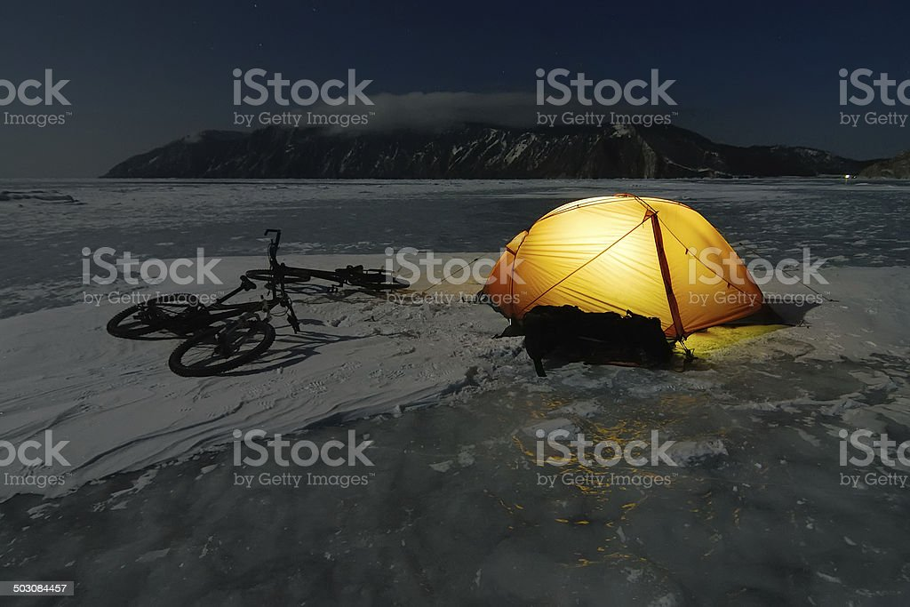 Bicycle tourists winter camp stock photo