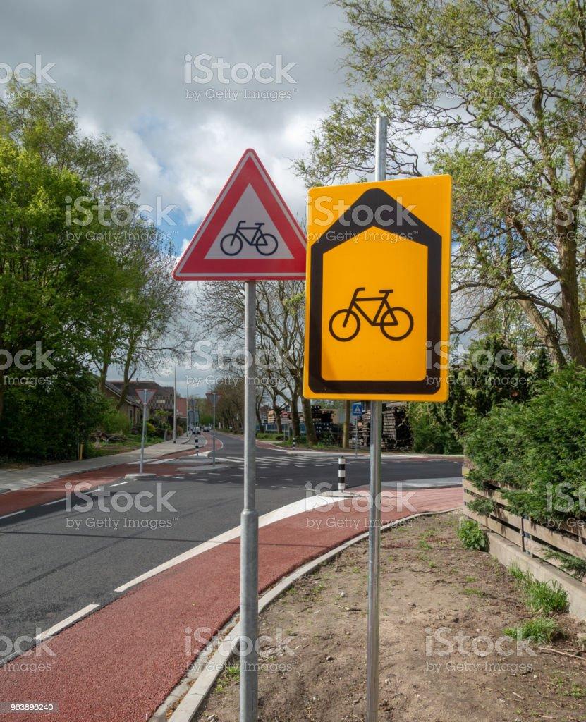 Bicycle warning and detour on bicycle lane - Royalty-free Asphalt Stock Photo