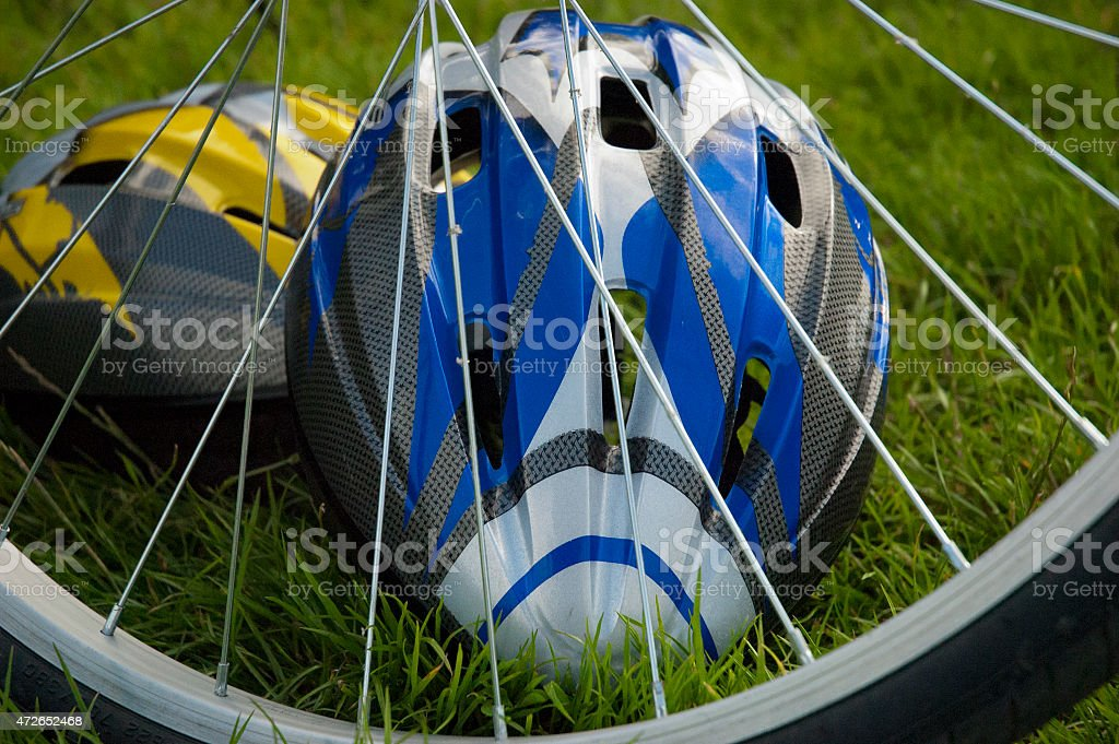 Bicycle wheel and helmets stock photo