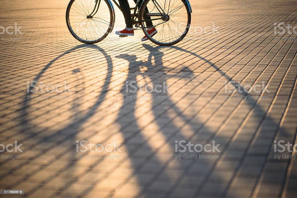 Bicycle wheel and shadow stock photo