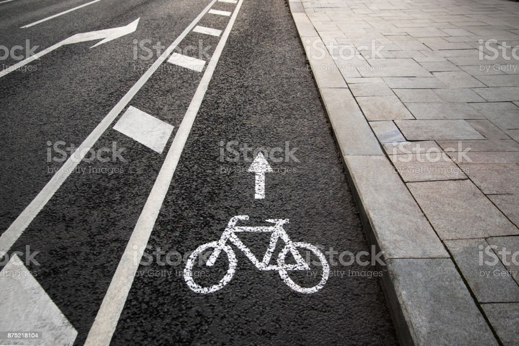 Bicycle white sign or icon on the asphalt road in the city stock photo