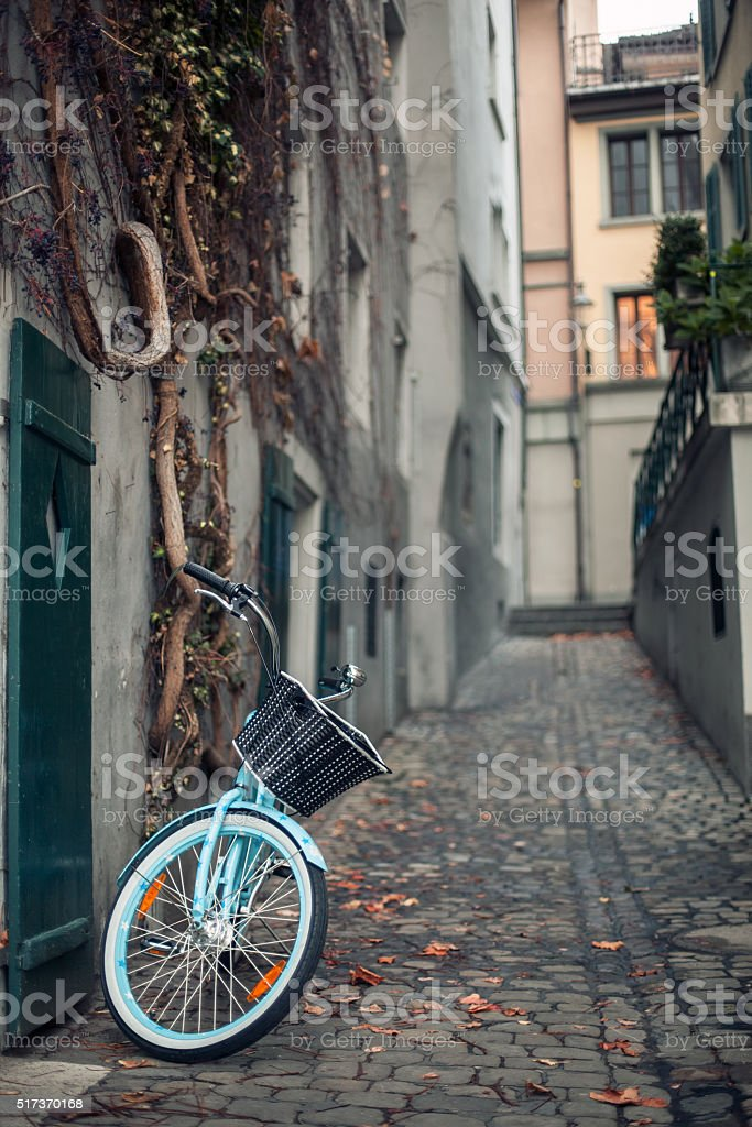 bicycle with basket parked on the street of old town stock photo
