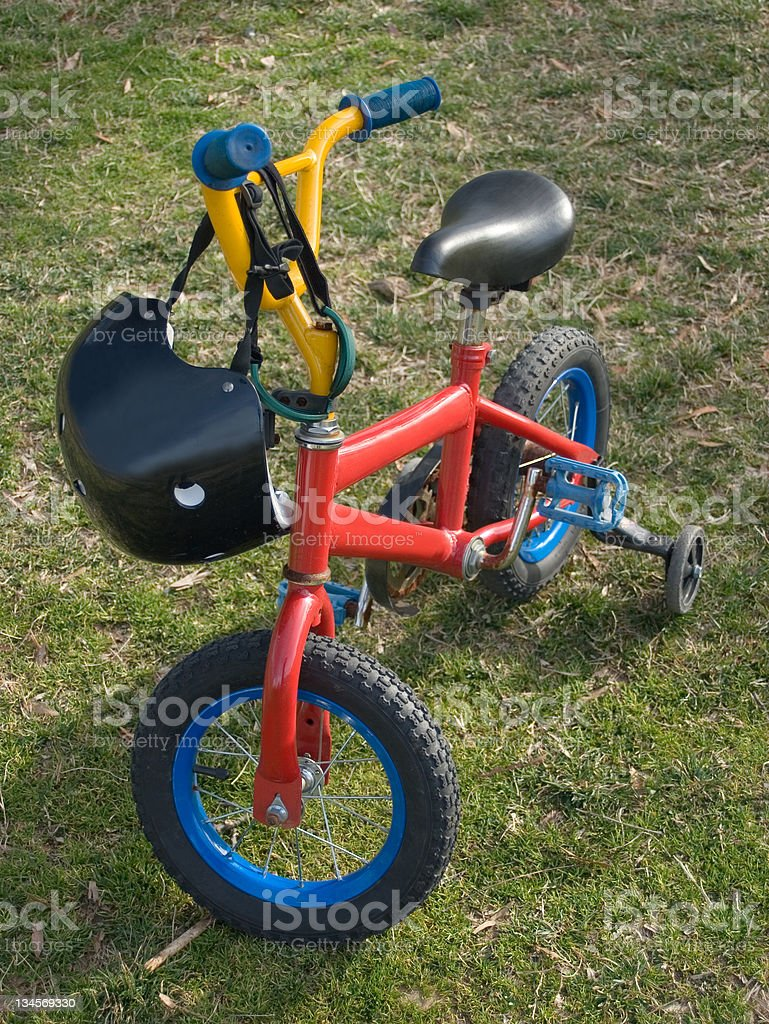 Bicycle with helmet and training wheels royalty-free stock photo