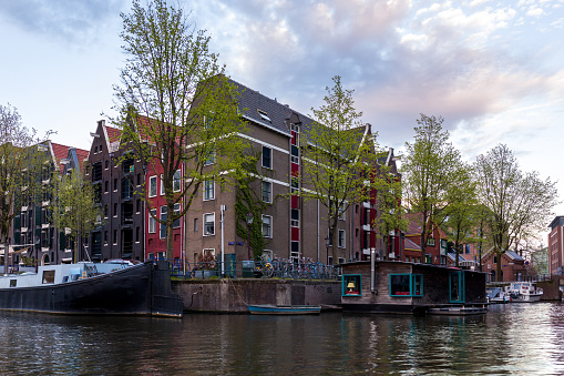 Bicycles and Canal Houses in Amsterdam, Netherlands. Bicycles and houses on the water are the hallmarks of Amsterdam.