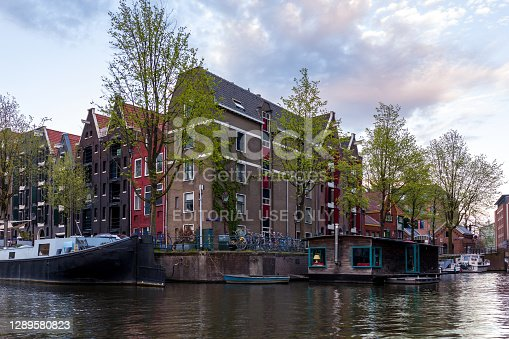 istock Bicycles and Canal Houses in Amsterdam, Netherlands. Bicycles and houses on the water are the hallmarks of Amsterdam. 1289580823