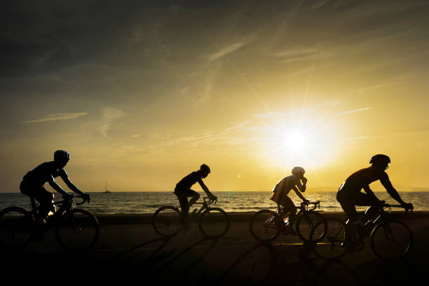 Bicycles are riding along the beach, bicycles during the evening hours. stock photo