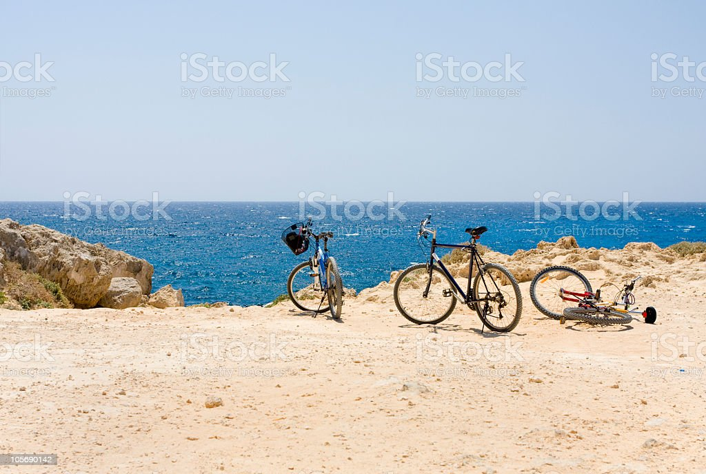 Bicycles at isolated sandy beach stock photo