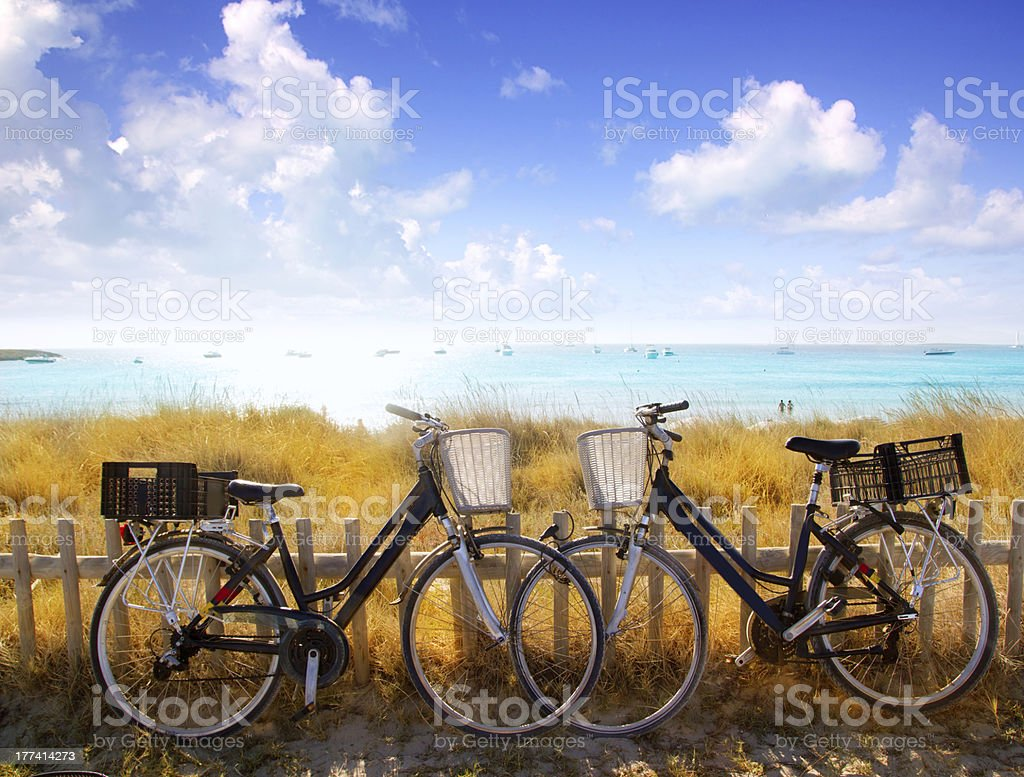 bicycles couple parked in Formentera beach stock photo