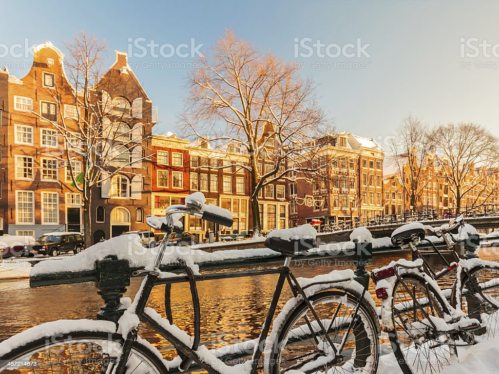 Bicycles covered with snow during winter in Amsterdam stock photo