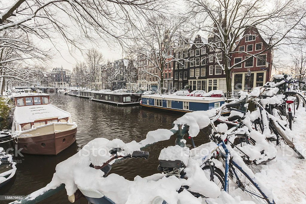Bicycles covered with snow in Amsterdam stock photo