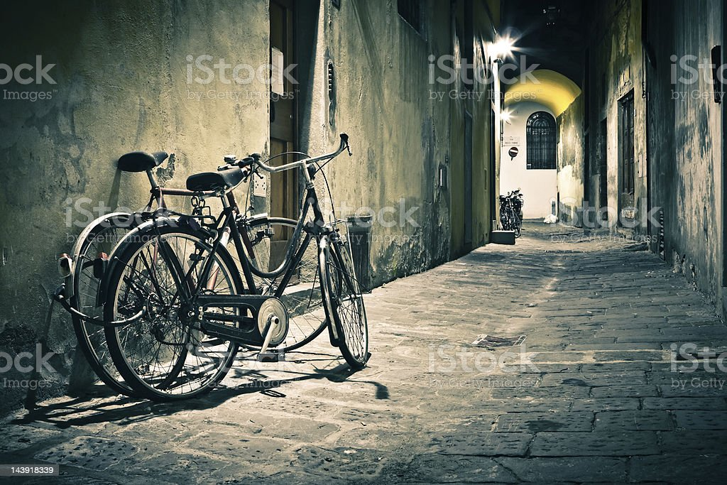 Bicycles in a Dark Alley, Firenze at Night royalty-free stock photo