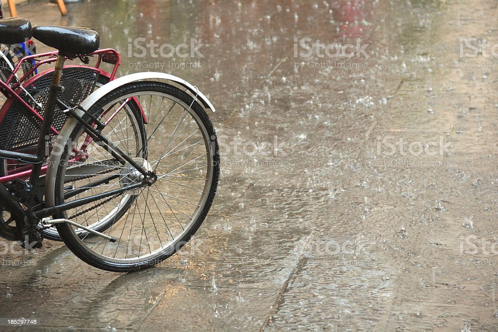 Bicycles in rain royalty-free stock photo
