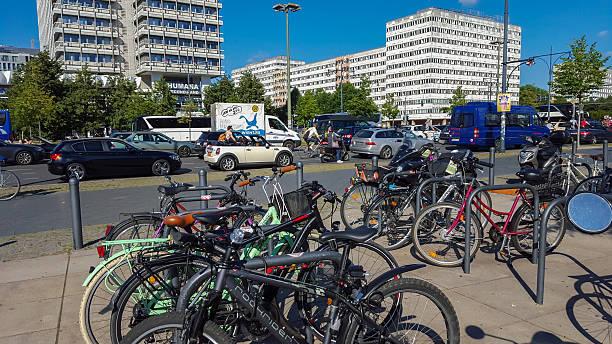 bicycles in the near of u-bahn station berlin alexanderplatz - u bahn stock-fotos und bilder