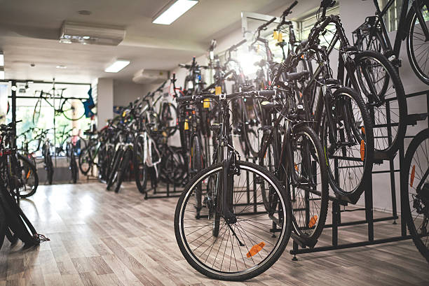 Bicycles inside the store Bicycles arranged inside the bicycle store. bicycle shop stock pictures, royalty-free photos & images