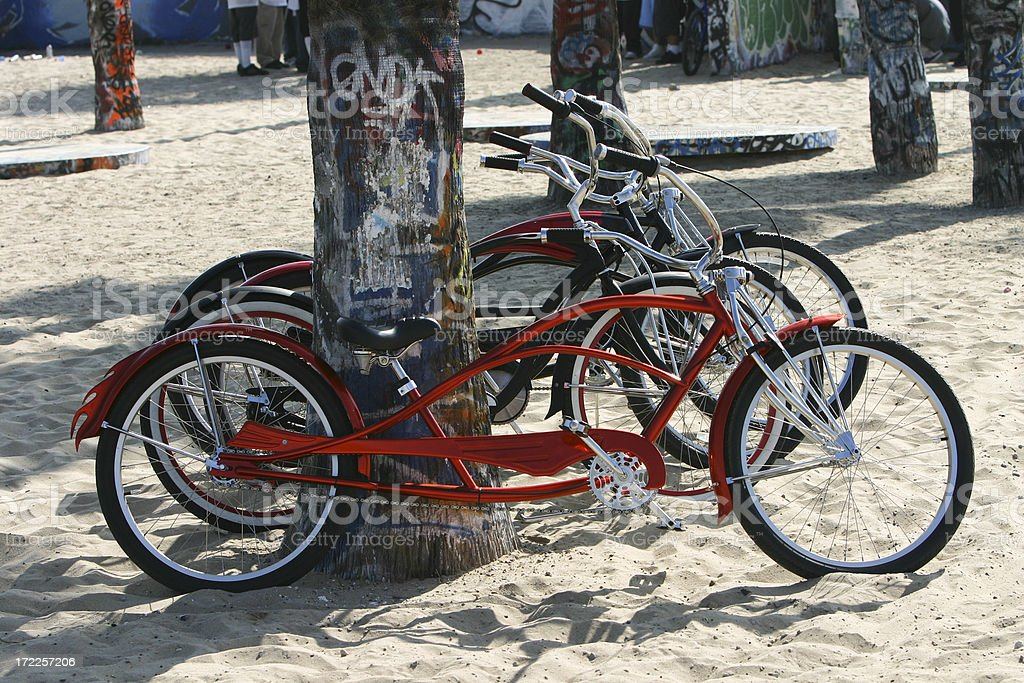 Bicycles leaning against ocean pier pylon royalty-free stock photo