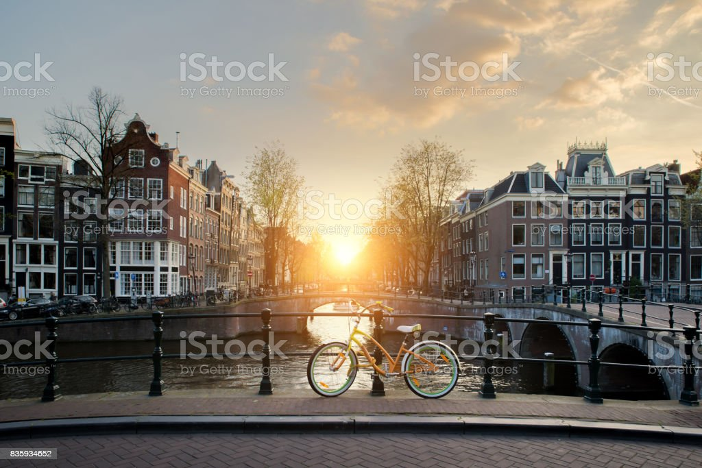 Bicycles lining a bridge over the canals of Amsterdam, Netherlands. Bicycle is major form of transportation in Amsterdam, Netherlands stock photo