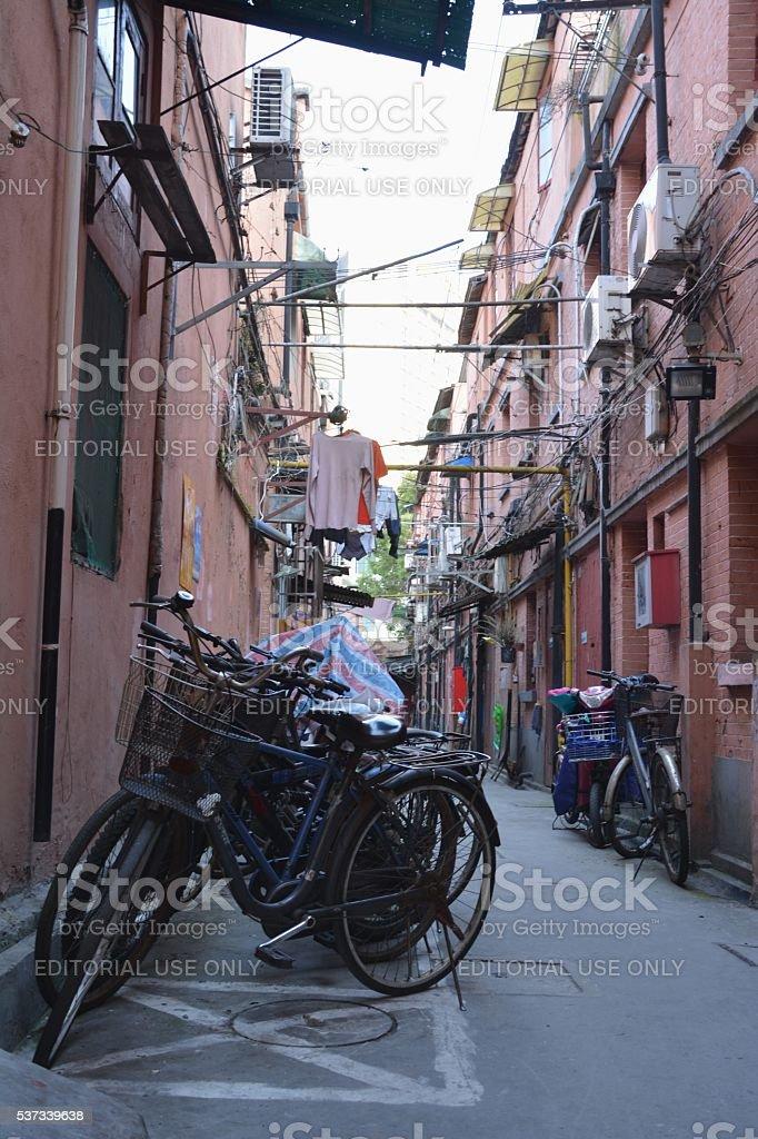 Bicycles on a Shikumen alley in Hongkou district, Shanghai, China stock photo