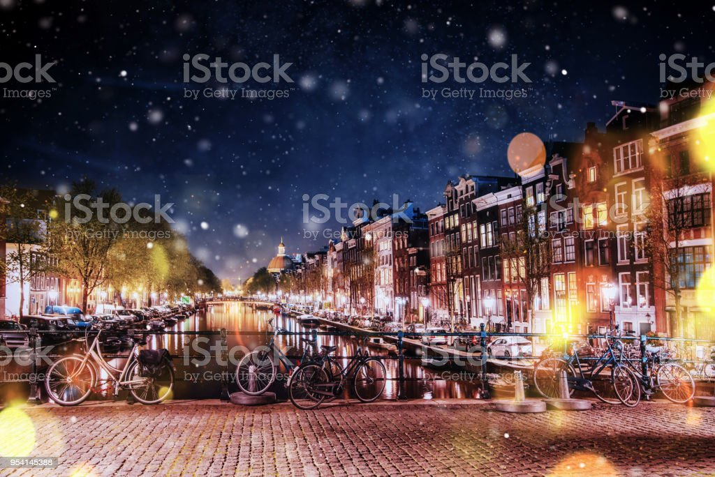 Bicycles Parked Along a Bridge Over the Canals of Amsterdam, Net stock photo
