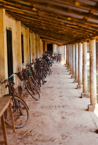 Bicycles parked around a school corridor stock photo