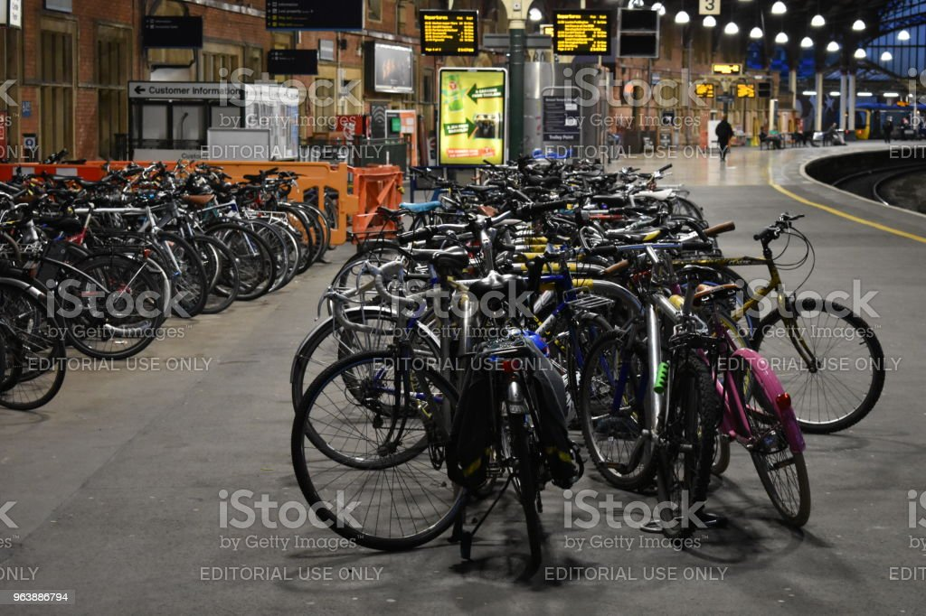 Bicycles parked at Bristol Temple Meads railway station - slight zoom - Royalty-free Bicycle Stock Photo