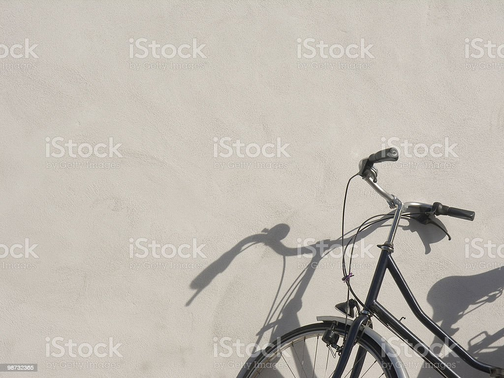 Bicycles; Parked Bike against cream wall royalty-free stock photo