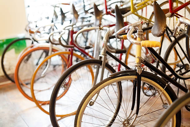 Bicycles parked in a bike shop Bicycles parked in a bike shop bicycle shop stock pictures, royalty-free photos & images