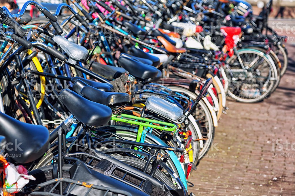 Bicycles Parked In A Row at Amsterdam, Netherlands royalty-free stock photo