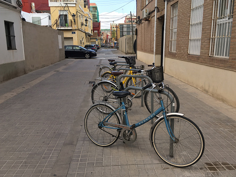 Bicycles parked in the street in El Cabanyal district in Valencia, Spain