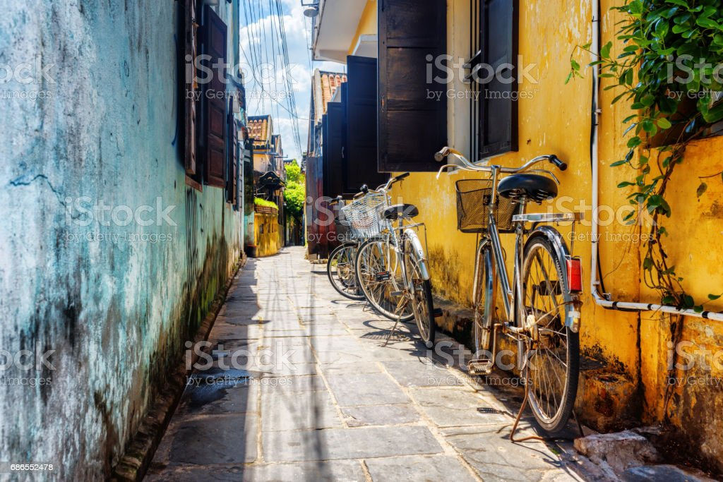Bicycles parked near yellow wall, Hoi An Ancient Town royalty-free stock photo