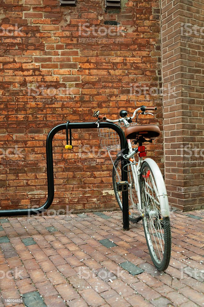 Bicycles parked next to the brick wall in Distillery District royalty-free stock photo