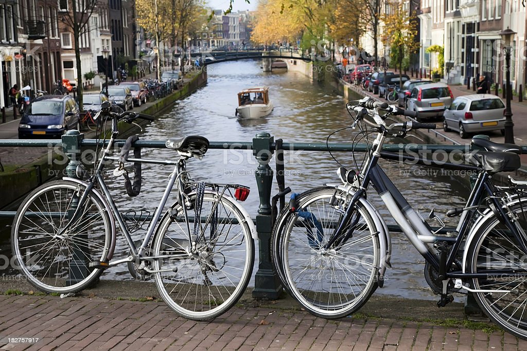 Bicycles parked on a canal bridge in Amsterdam (XXXL) royalty-free stock photo
