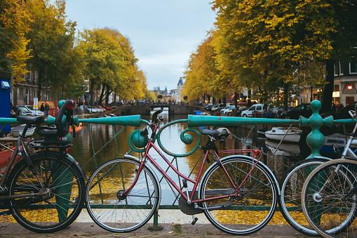 Bicycles standing on bridge, amazing Amsterdam view.
