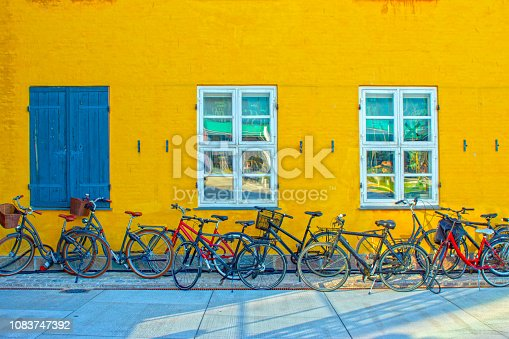 Many bicycles up against a wall in Copenhagen, Denmark.