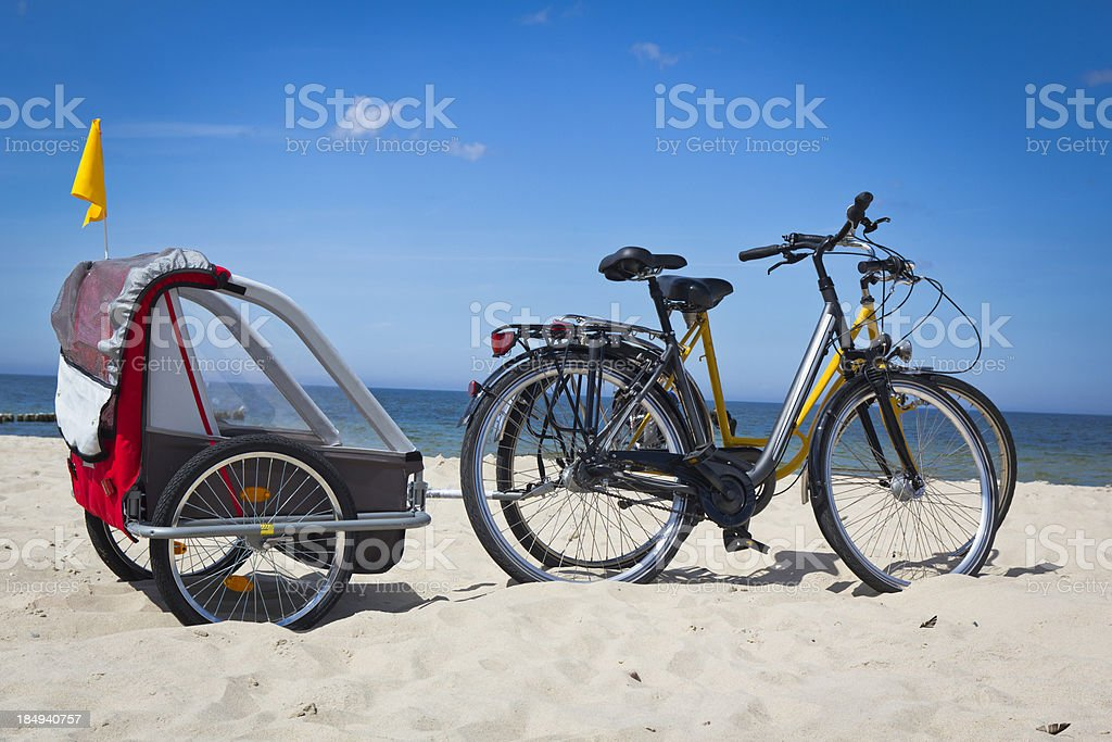 Bicycles with a baby trailer royalty-free stock photo