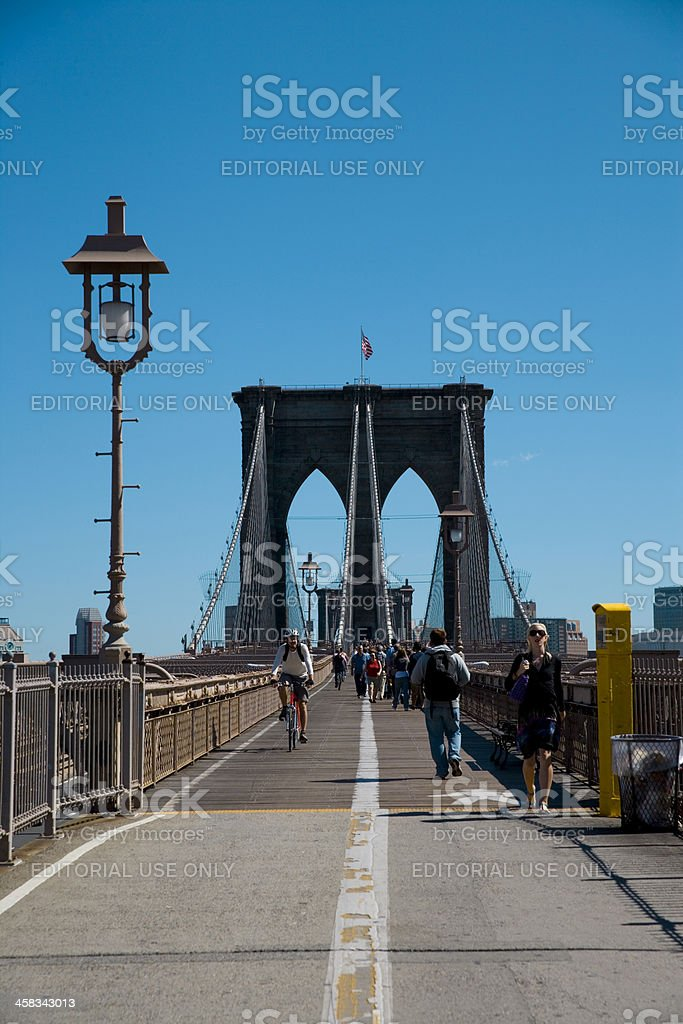 Bicycling and tourists on Brooklyn Bridge, New York City royalty-free stock photo