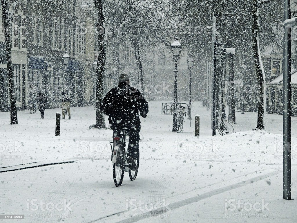 Bicycling; Bicyclist in the winter royalty-free stock photo