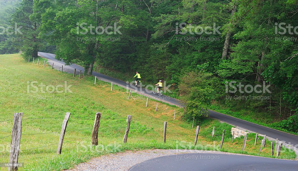 Bicycling on a country road in the Smoky  Mountains stock photo