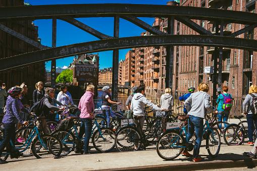 Bicycling tour in old Speicherstadt near Wandrahmsfleet house in Hamburg