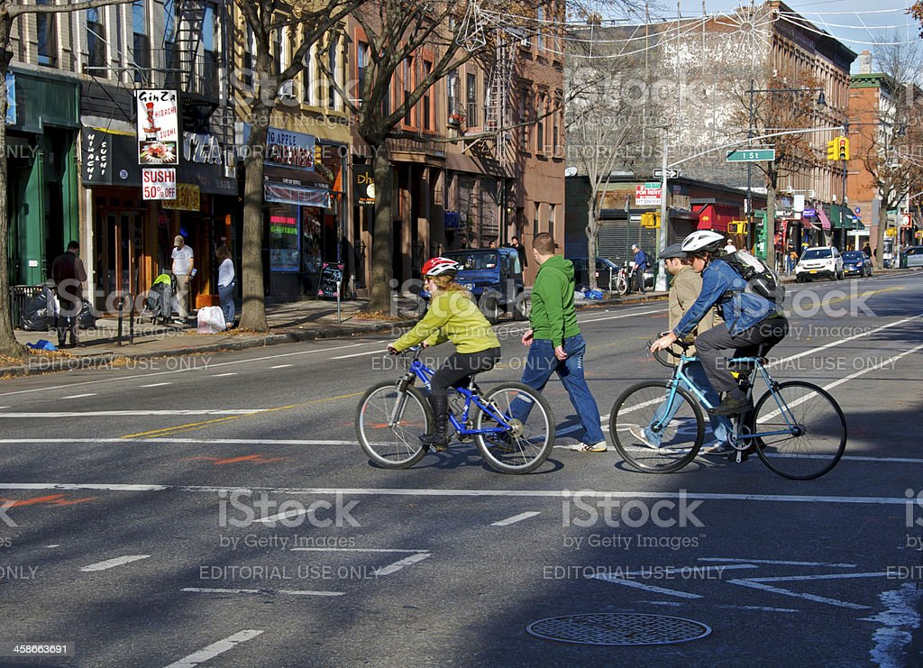 Bicycling & walking in Park Slope, Brooklyn, New York City royalty-free stock photo