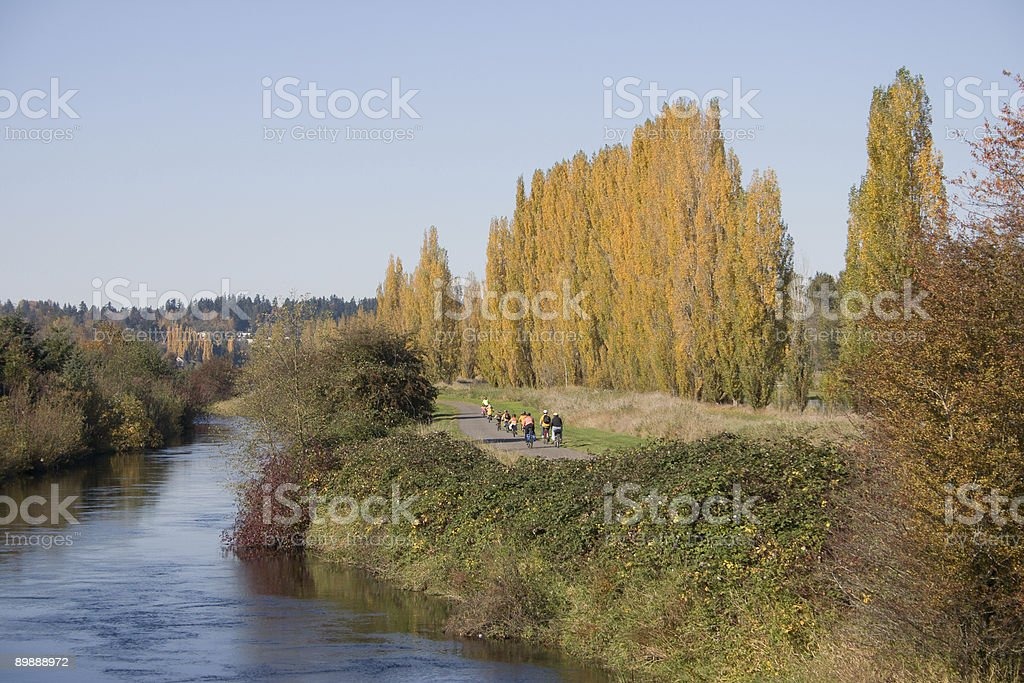 Bicyclist group in fall color royalty-free stock photo