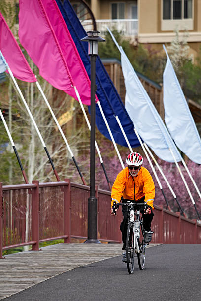 bicyclist in bend - bend oregon stock pictures, royalty-free photos & images