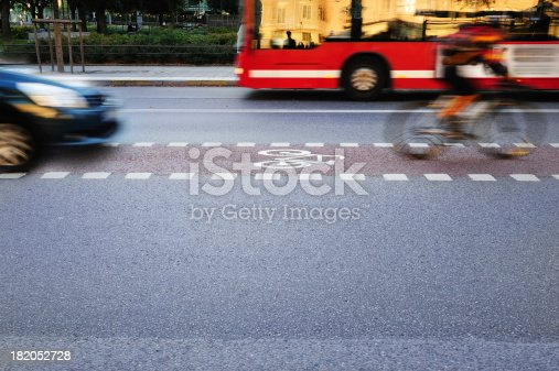 istock Bicyclist in bike lane 182052728