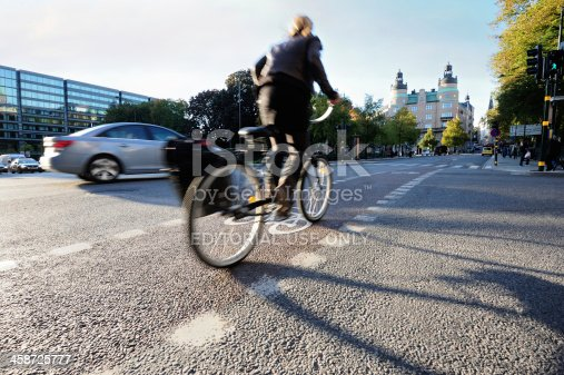 667005568istockphoto Bicyclist in bike lane 458725777