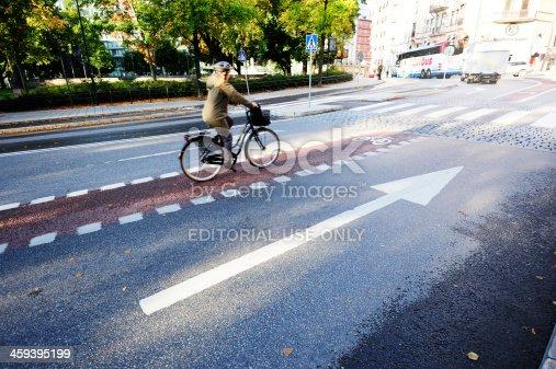 667005568 istock photo Bicyclist in bike lane 459395199