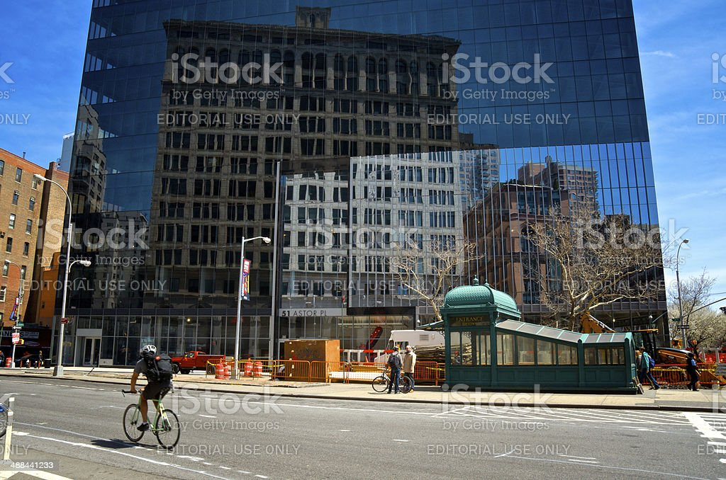 Bicyclist Passing 4th Ave & Astor Place, Manhattan, NYC stock photo