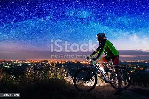 istock Bicyclist with mountain bike on top of the hill 638756428