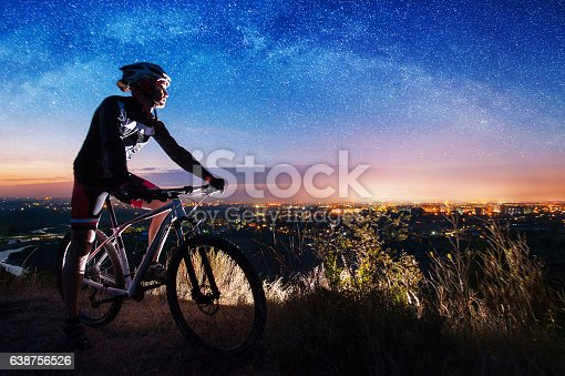 istock Bicyclist with mountain bike on top of the hill 638756526
